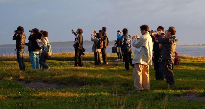 Delegazione giapponese in visita all'isola Kunashir
