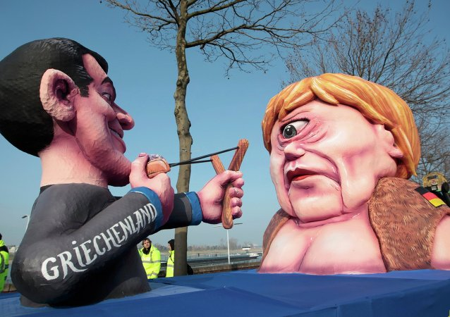 A carnival float with papier-mache caricatures of German Chancellor Angela Merkel (R) and a figure representing Greece (L) takes part in the traditional Rose Monday carnival parade in the western German city of Duesseldorf February 16, 2015