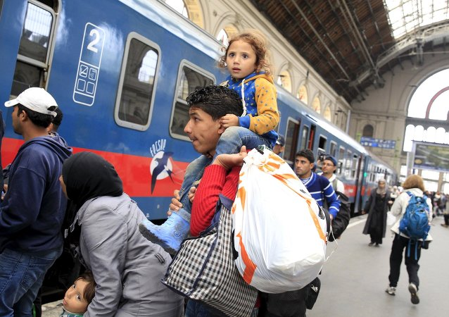Migrants, who mostly crossed into the country from Serbia and are hoping to make their way to Austria, prepares to board a train heading to Hegyeshalom, at Keleti station in Budapest, Hungary, September 12, 2015