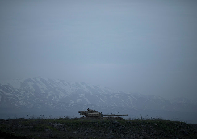 An old Israeli tank sits in a position in the Israeli-controlled Golan Heights near the border with Syria
