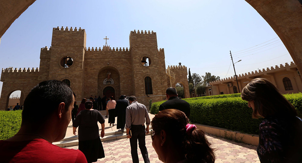 Iraqi Christians head to the Saint Joseph church in Arbil, the capital of the autonomous Kurdish region, on August 6, 2015