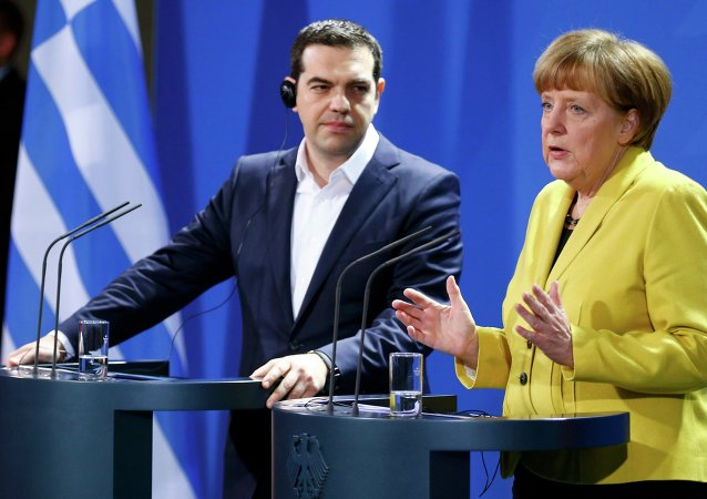 German Chancellor Angela Merkel and Greek Prime Minister Alexis Tsipras address a news conference following talks at the Chancellery in Berlin March 23, 2015