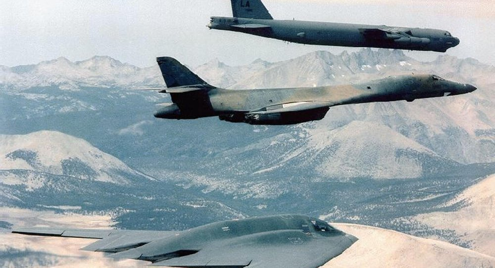 B-2 Spirit (bottom) bomber flying with B-1B (C) and B-52 bombers at an undisclosed location