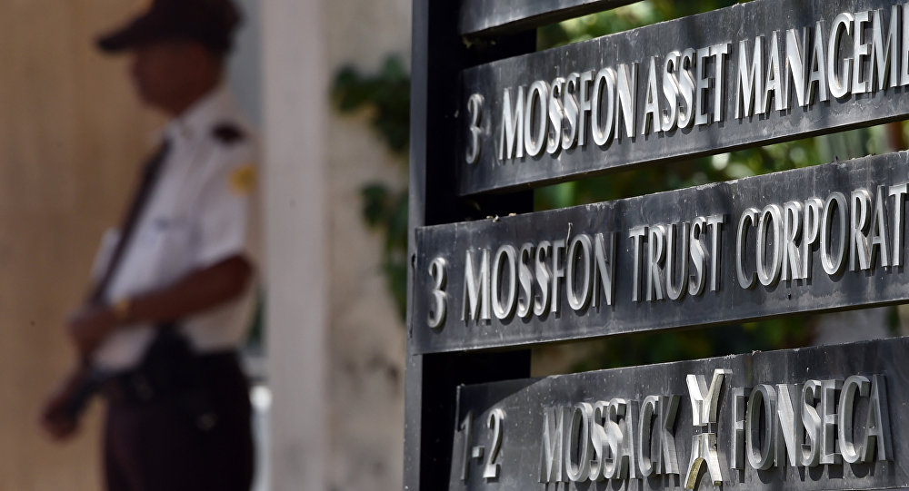 A private security guard stands outside the building where Panama-based Mossack Fonseca law firm is based, in Panama City, on April 5, 2016