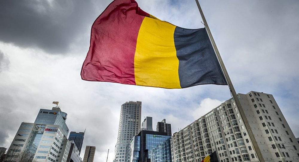 The Belgian flag flying at half-mast is pictured at the Hofplein in Rotterdam, on March 23, 2016.