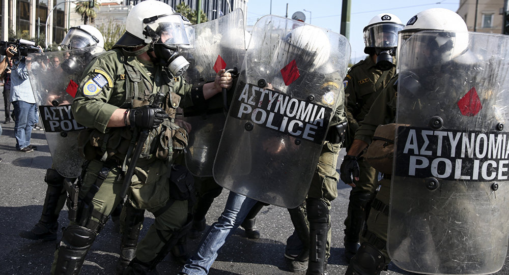 Policemen detain a farmer during an anti-government protest at central Syntagma square in Athens