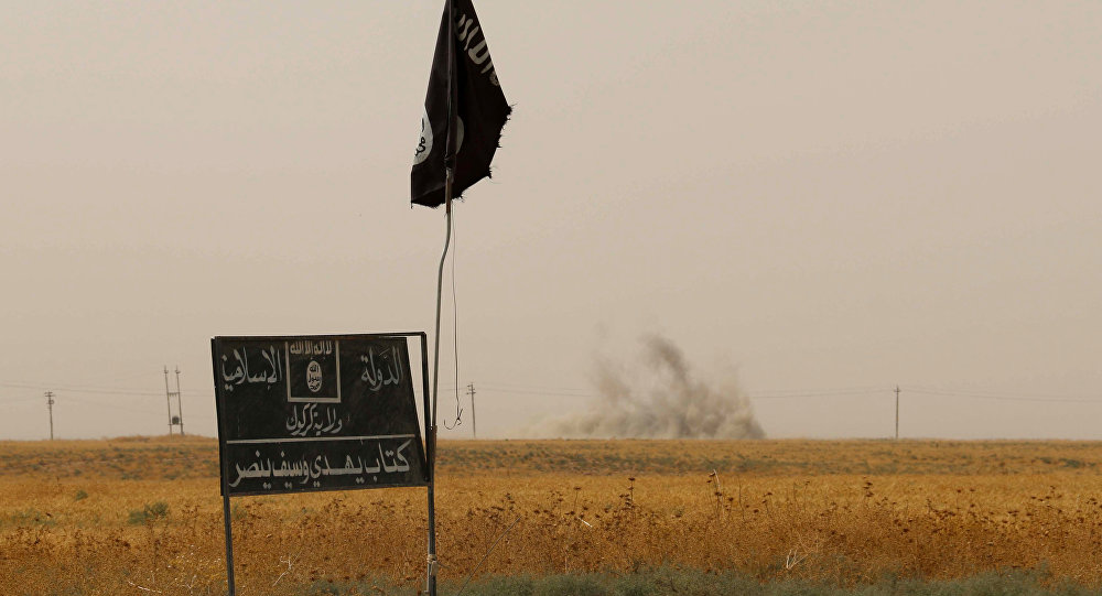 Bandiera e cartellone del Daesh