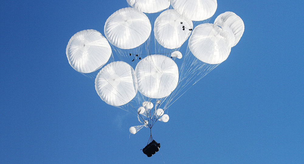 Airborne combat vehicles air dropped during the joint battalion tactical exercise of airborne troops