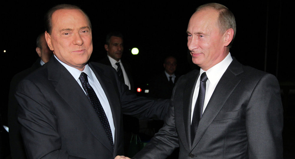 Russian Prime Minister Vladimir Putin (right) meets his Italian counterpart Silvio Berlusconi (left), 2010