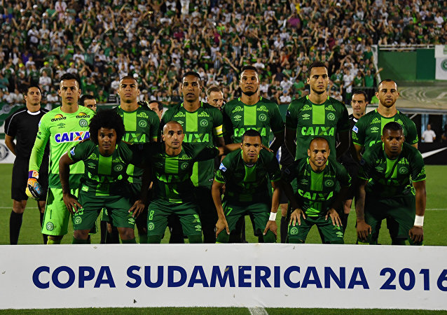 Brazil's Chapecoense players pose for pictures during their 2016 Copa Sudamericana semifinal second leg football match against Argentina's San Lorenzo held at Arena Conda stadium, in Chapeco, Brazil, on November 23, 2016.