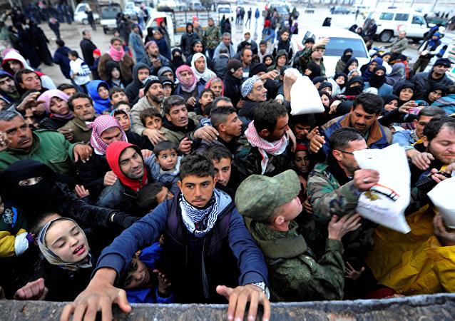 Siriani evacuati da Aleppo est.