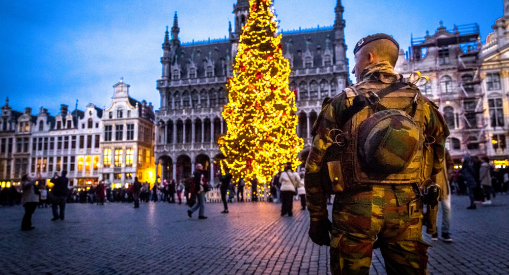 A serviceman patrols on the Grand-Place (Groote Markt) on the sidelines of the winter wonders Christmas market, in Brussels