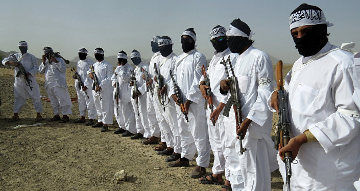 File, In this Aug. 15, 2016 photo, Taliban suicide bombers stand guard during a gathering of a breakaway Taliban faction, in the border area of Zabul province, Afghanistan