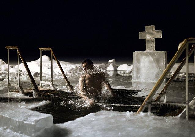 People bathe on Epiphany Day in the lake of the Valdai Our Lady of Iberia Svyatoozyorsky (Holy Lake) Monastery