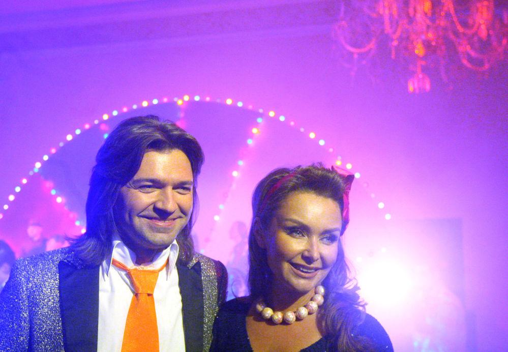 Il cantante russo Dmitry Malikov e sua moglie Elena.