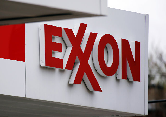 FILE - This April 29, 2014, file photo, shows an Exxon sign at an Exxon gas station in Carnegie, Pa. Low oil prices have helped cost Exxon its pristine AAA credit rating from Standard & Poor's, a label it held for over six decades, S&P announced Tuesday, April 26, 2016.