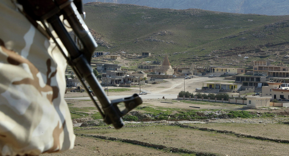 In this Sunday Jan. 11, 2015 photo, a Yazidi fighter protects the Sharaf al-Deen temple shrine, one of the holiest for the Yazidis, a religious minority whom the Islamic State group considers heretics ripe for slaughter, in Sinjar, northern Iraq