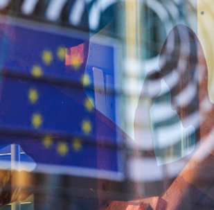 Reflection of the EU flag in a window of a building in Brussels.