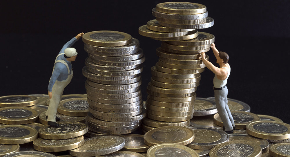 Picture taken on July 26, 2012 in Paris shows an illustration made with figurines and euro coins