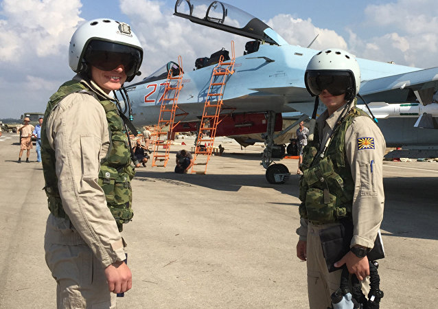 Russian pilots prepared to board the SU-30 attack plane to take off from the Hmeimim aerodrome in Syria.