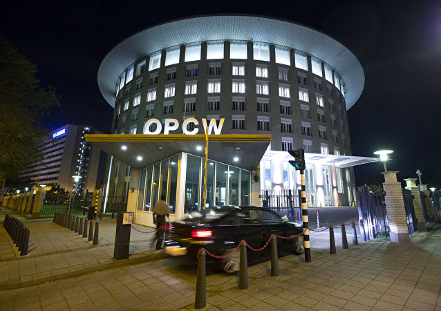 A car arrives at the headquarters of the Organization for the Prohibition of Chemical Weapons, OPCW, in The Hague, Netherlands.