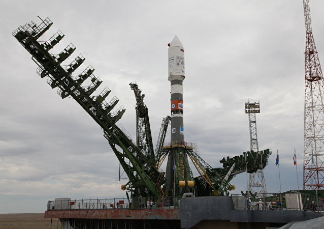 Soyuz-2.1a rocket being moved to a launch pad at the Baikonur Cosmodrome
