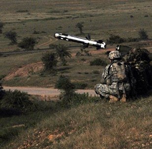 Under the instruction of a U.S. Soldier, an Indian Army soldier fires a Javelin missile as part of Yudh Abhyas, a bilateral training exercise designed to develop and expand upon the relationship between the two armies.