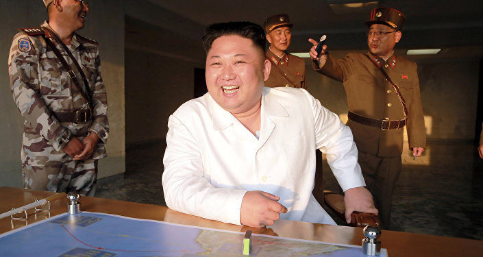 North Korean leader Kim Jong Un reacts during a ballistic rocket test-fire through a precision control guidance system in this undated photo released by North Korea's Korean Central News Agency (KCNA) May 30, 2017