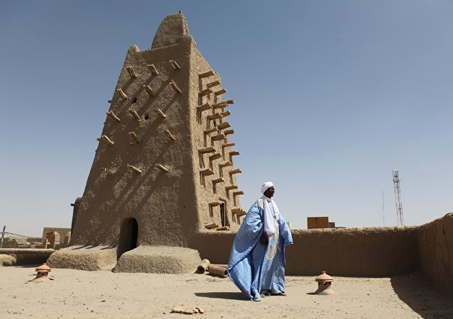 A man stands in front of the Djingareyber mosque on February 4, 2016 in Timbuktu, central Mali.