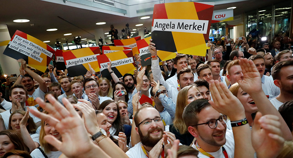People at the Christian Democratic Union CDU headquarters react on first exit polls in the German general election (Bundestagswahl) in Berlin, Germany, September 24, 2017