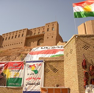 Banners calling for voting in a referendum on Iraqi Kurdistan independence from Baghdad in Erbil