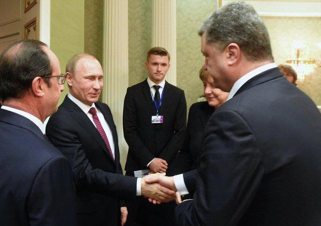 Hollande, Putin, Merkel e Poroshenko (foto d'archivio)