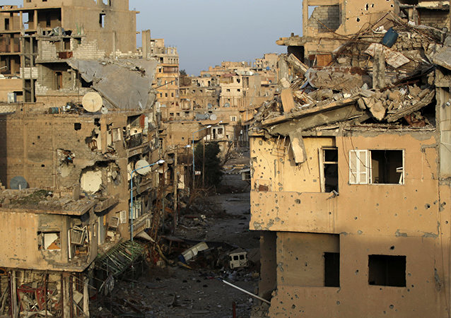 A view shows damaged buildings in Deir al-Zor, eastern Syria February 19, 2014