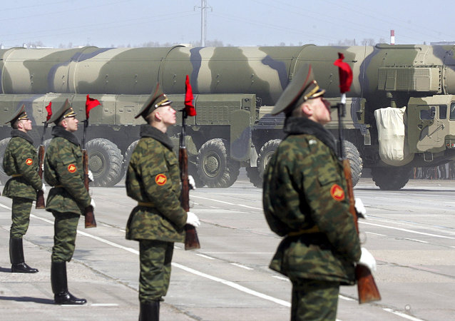Russian soldiers stand near a Topol-M ICBM while participating in a rehearsal for the nation's Victory Day parade outside Moscow in Alabino on April 22, 2008