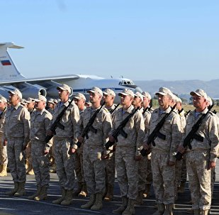 Russian army servicemen during the ceremony of meeting President Vladimir Putin at the Khmeimim Air Base in Syria