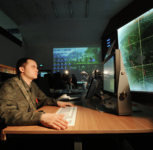 Officers with the 4th Brigade Air Defense (NORAD) air and space defense (ASD) forces in the combat control room in the Moscow region