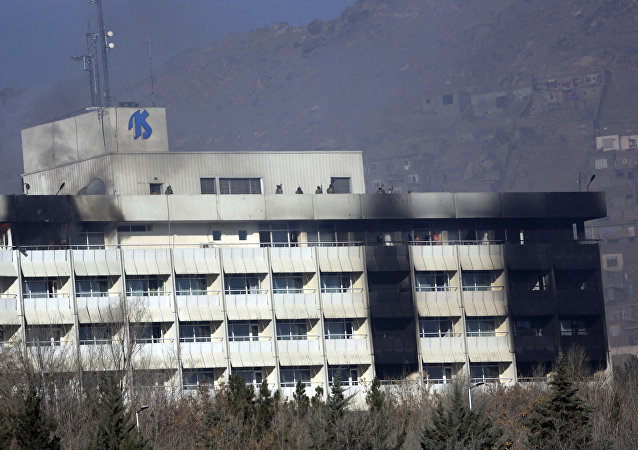 Afghan security personnel are seen at the roof of Intercontinental Hotel after an attack in Kabul, Afghanistan, Sunday, Jan. 21, 2018. Gunmen stormed the hotel and sett off a 12-hour gun battle with security forces that continued into Sunday morning, as frantic guests tried to escape from fourth and fifth-floor windows