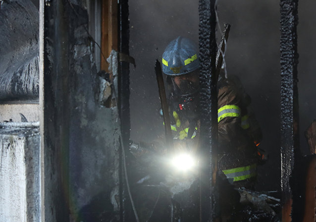 Firefighters put out a fire at a burning hospital in Miryang, South Korea