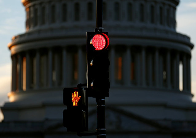 A traffic light shines red after President Donald Trump and the U.S. Congress failed to reach a deal on funding for federal agencies in Washington, U.S., January 20, 2018