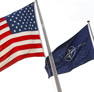 NATO and U.S. flags fly at the entrance of the Alliance's headquarters during a NATO foreign ministers meeting in Brussels, Belgium March 31, 2017
