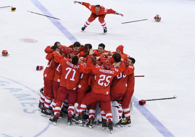 Russian ice hockey players celebrating their victory in the final match between Russia and Germany in the men's ice hockey tournament at the 2018 Winter Olympics