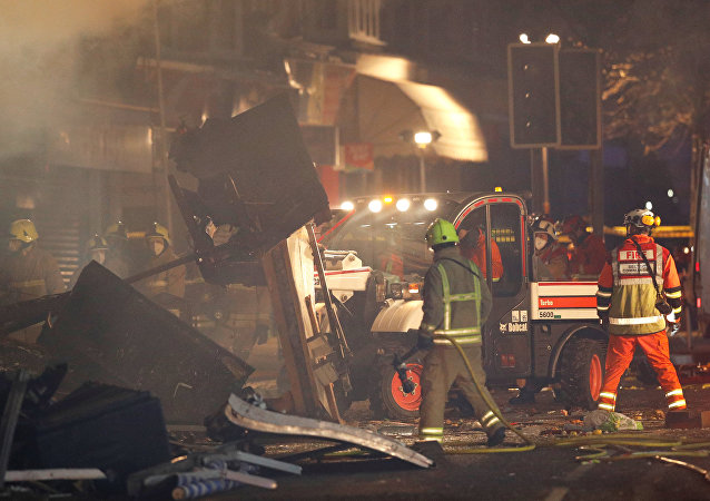 Members of the emergency services move debris at the site of an explosion which destroyed a convenience store and a home in Leicester, Britain, February 25, 2018