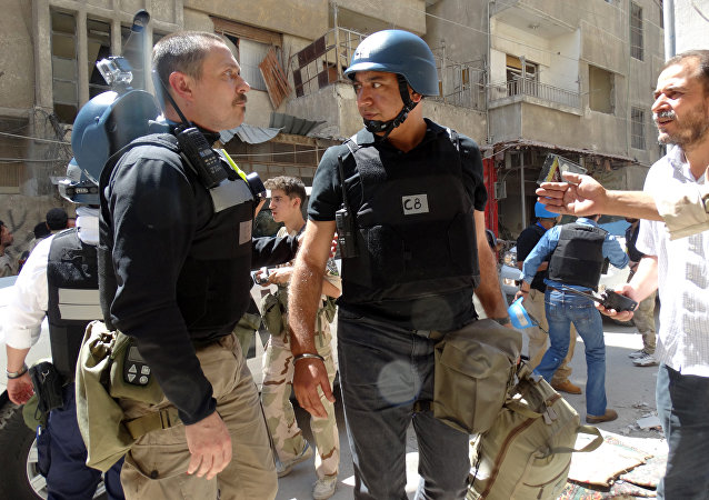 United Nations (UN) arms experts arrive to inspect a site suspected of being hit by a deadly chemical weapons attack last week in the Eastern Ghouta area on the northeastern outskirts of Damascus. (File