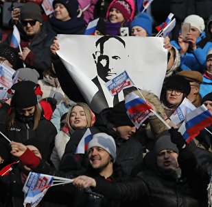 People take part in a rally to support Russian President Vladimir Putin in the upcoming presidential election at Luzhniki Stadium in Moscow, Russia March 3, 2018