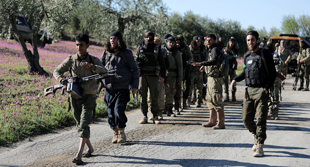 Turkish-backed Free Syrian Army fighters walk together after advancing north of Afrin, Syria March 17, 2018