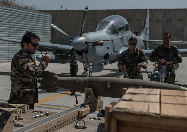 Afghan munitions Airmen move an Mark-81 bomb toward an A-29 Super Tucano Sept. 12, 2017, in Kabul, Afghanistan. Munitions crews regularly train loading procedures in order to hone and practice their skills, while also supporting active combat operations against anti-government forces throughout Afghanistan.