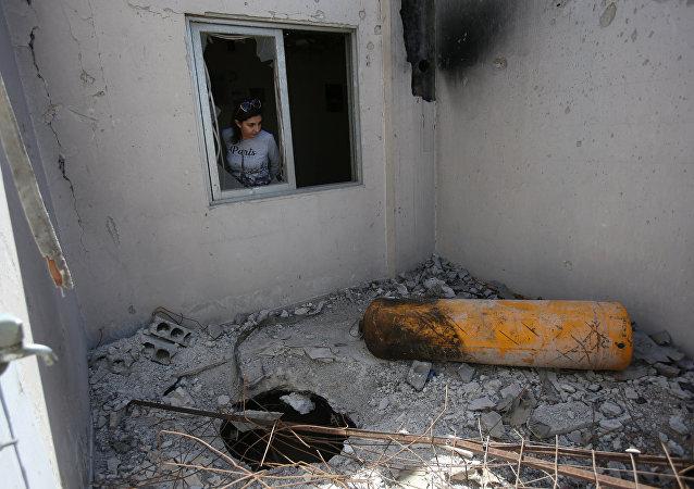 Giornalisti ed ispettori dell'OPAC visitano Douma, Siria