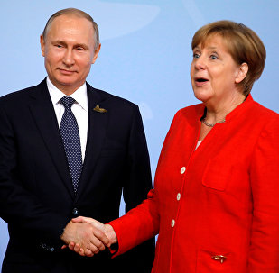 German Chancellor Angela Merkel welcomes Russia's President Vladimir Putin at the G20 summit in Hamburg, Germany July 7, 2017