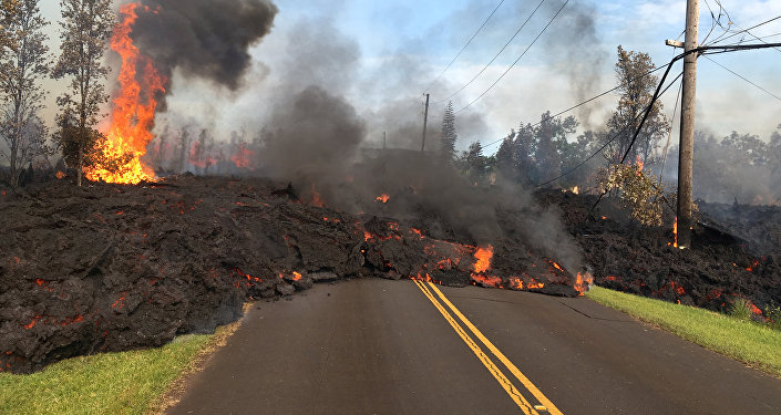 Lava advances along a street near a fissure in Leilani Estates, on Kilauea Volcano's lower East Rift Zone, Hawaii, the U.S., May 5, 2018