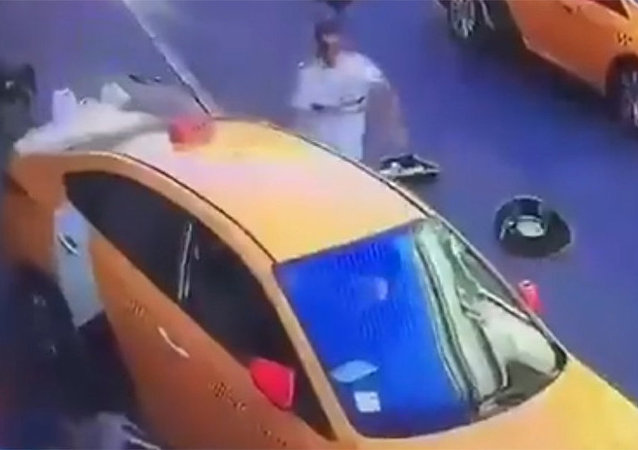 Screengrab of a video showing a taxi ramming into pedestrians in central Moscow, Russia, June 16, 2018.
